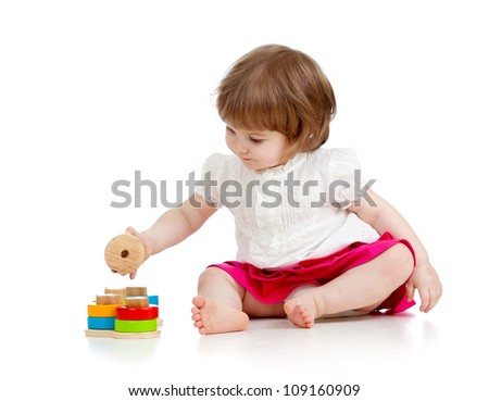 child girl playing with educational toy - stock photo