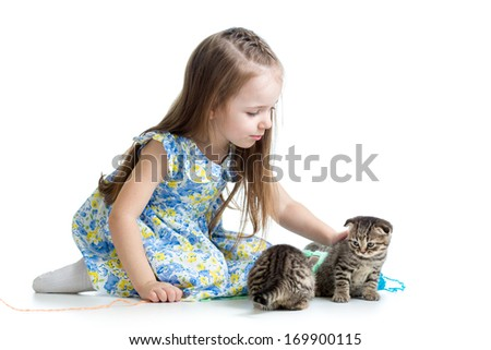 child girl playing with kitten isolated on white background - stock photo
