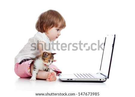 child girl protecting notebook from kitten - stock photo