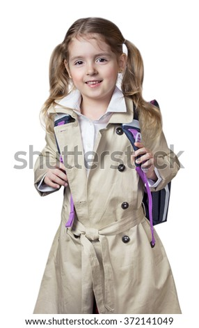 Child girl pupil school bag smile isolated on white.Kid caucasian in coat standing happy on white background. - stock photo
