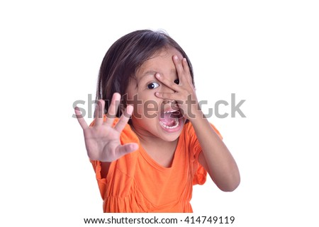 Child girl screams and with shocked expression - stock photo