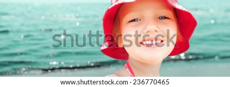 child girl smile face closeup sea summer vacations panorama background - stock photo