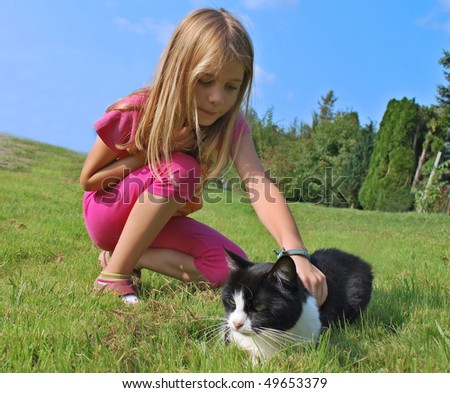 Child girl with cat - stock photo