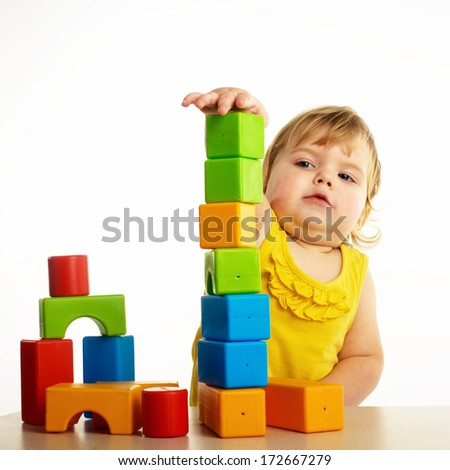 child girl with construction set over white background  - stock photo