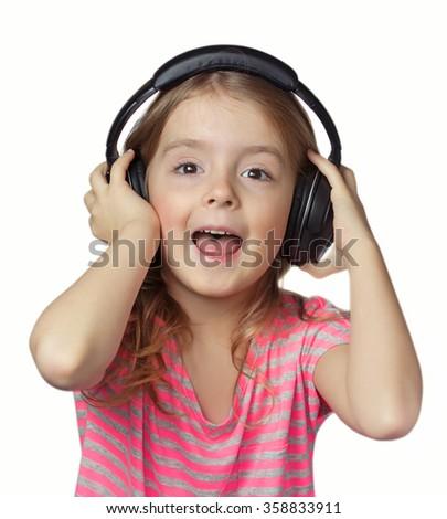 Child girl with earphones on head isolated.Kid in headphones singing. - stock photo