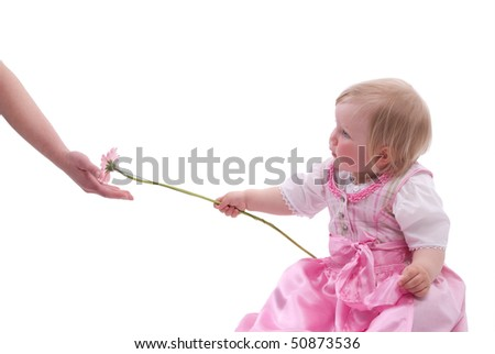 Child gives her mother flowers for Mother's Day - stock photo