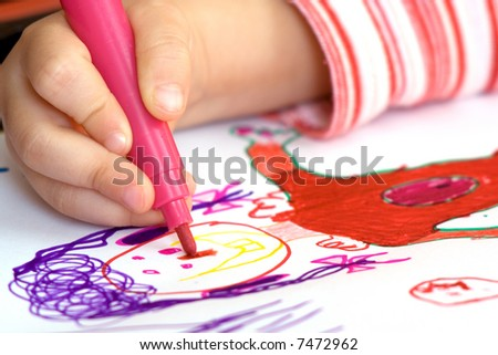 Child hand drawing - stock photo