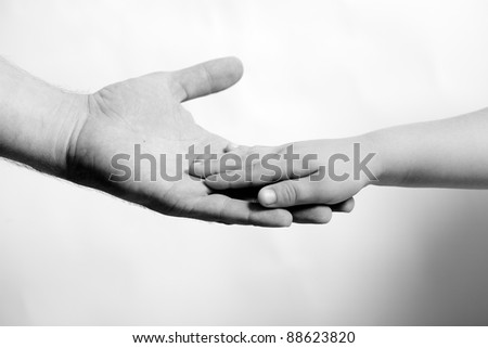 child hand hold by the adult hand - stock photo