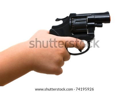 Child hand holding a toy gun. Isolated on white background - stock photo