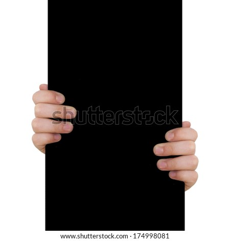 child hand on black background - stock photo