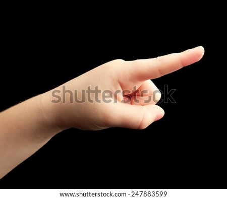 Child hand on black background - stock photo