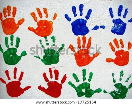 child hand prints on a wall