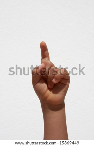 Child hand raised for answer or question - stock photo