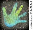 Child hand sketched on the ground. - stock photo