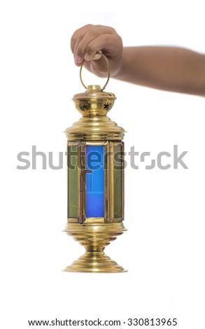 Child Hand with Ramadan Lantern Isolated on White Background - stock photo