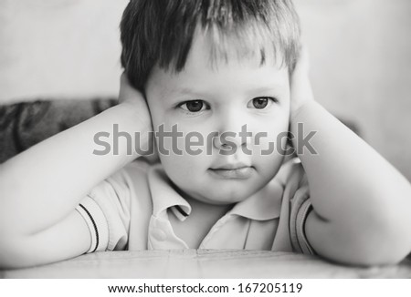 Child hands covering his ears, does not want to listen - stock photo