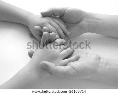 child hands in mother's ones - stock photo
