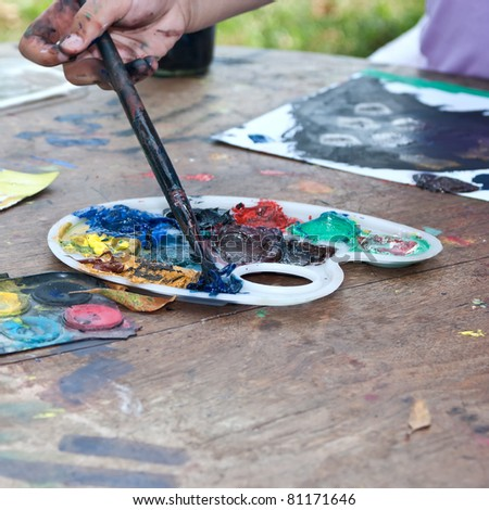Child hands painting close up photo - stock photo