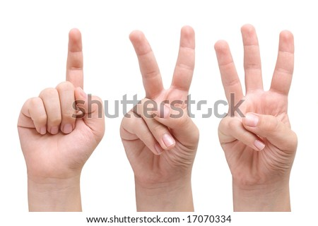 Child hands showing one, two and three fingers - stock photo