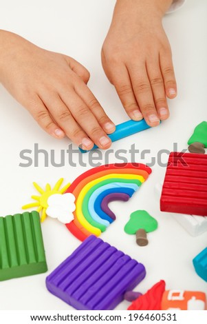 Child hands with modeling clay - closeup - stock photo