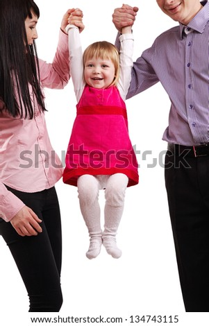 Child hanging on parents - stock photo