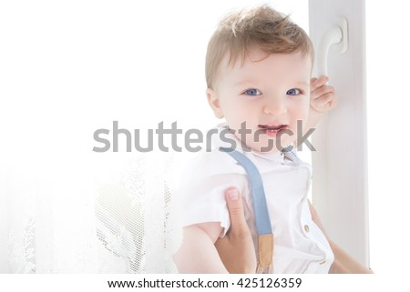 Child happiness and people concept - adorable baby. Boy. - stock photo
