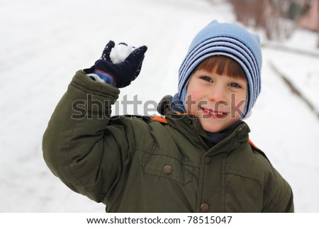 child have fun with snowball fight winter outdoor - stock photo