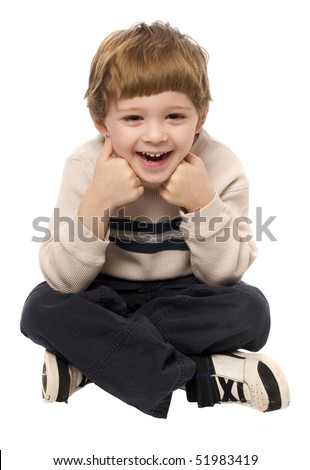 Child having a good time posing on a white background