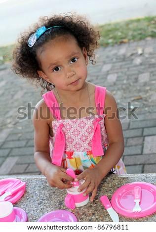Child Having a Tea Party - stock photo