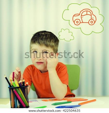 Child having an idea while drawing.