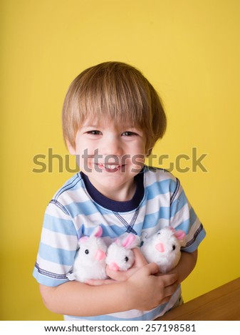 Child having fun and playing with wound up easter bunny toys