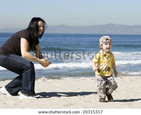 child having fun on the beach - stock photo