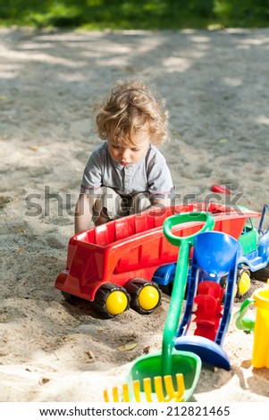 Child having fun on the playground, vertical - stock photo