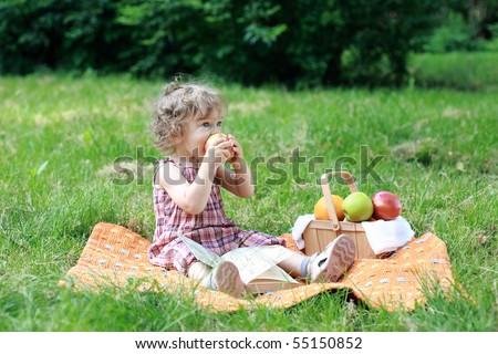 Child having picnic in park - shallow depth of field - stock photo