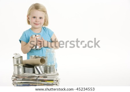 Child Helping With Recycling - stock photo
