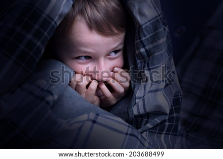 Child hiding under the blanket - stock photo
