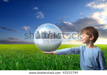 child holding a city inside a sphere - stock photo