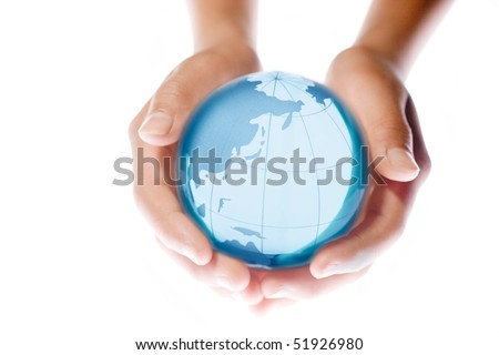 Child holding a globe in hands - stock photo