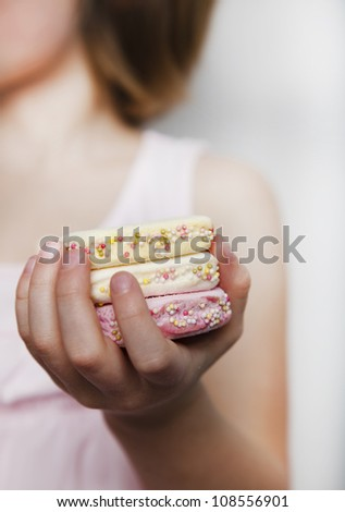 Child holding a handful of marshmallows candy - stock photo