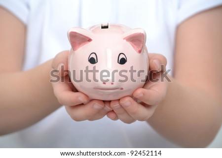 child holding a piggy bank - stock photo