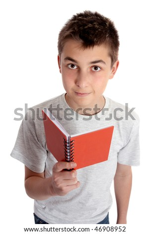 Child holding a red book and looking up.