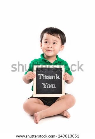 Child holding a thank you sign siting against white background  - stock photo