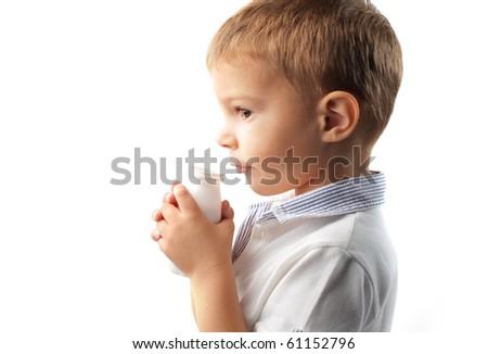 Child holding a yoghurt pot - stock photo