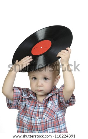 Child, holding an old vinyl record in his hands - stock photo