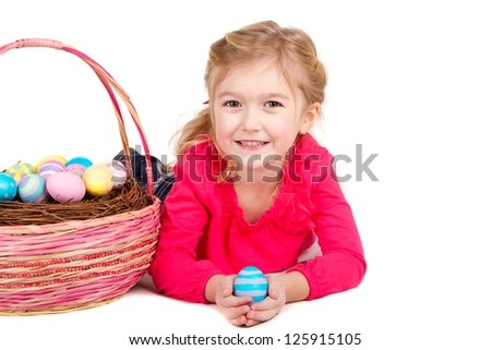 Child holding and easter egg with easter basket on white background - stock photo
