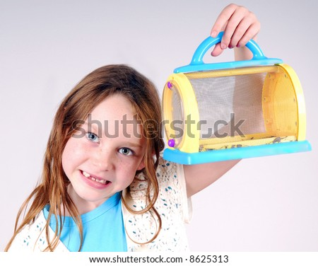 Child Holding Bug Catcher