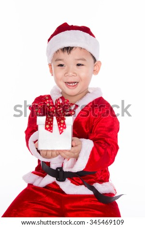 Child holding Christmas gift in hand. Isolated on white background. portrait of a happy little asian boy giving a gift box.  - stock photo