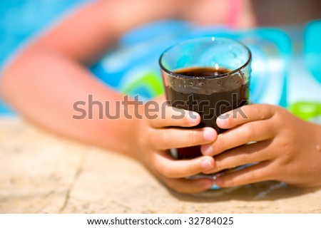 Child holding cola drink abstract vacations background - stock photo