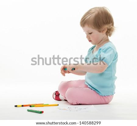 Child holding colorful felt-tip pens; white background - stock photo