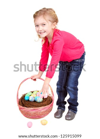 Child holding easter basket picking up easter eggs on a white background